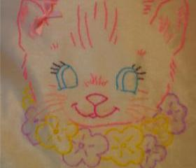 Hand embroidered vintage kitten cushion.